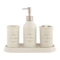 Set baño porcelana beige con lunares Le Bain 4 piezas: dispensador jabón, portacepillos, vaso y bandeja